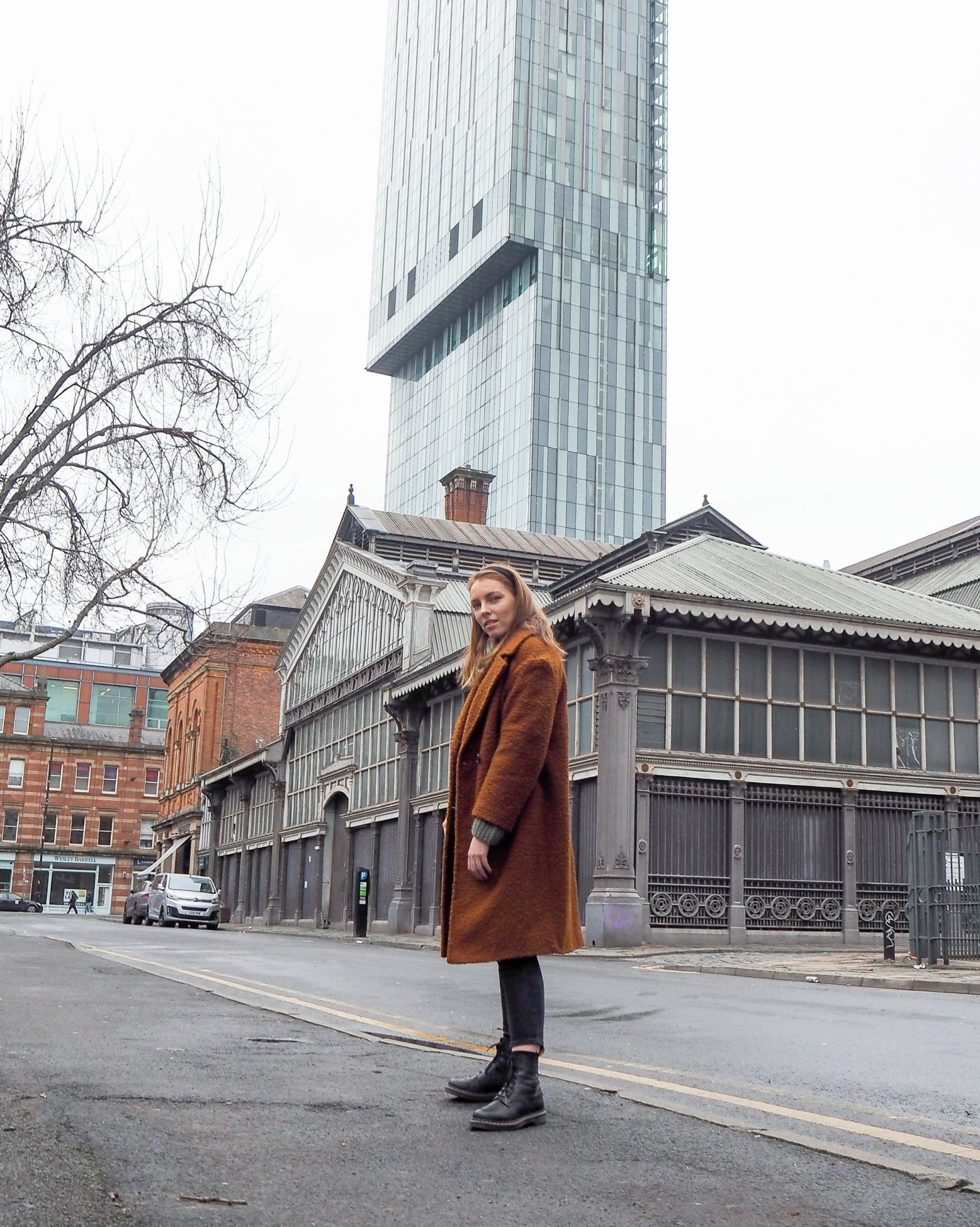 street style photography taken in Manchester girl wearing wool coat and dr Martens