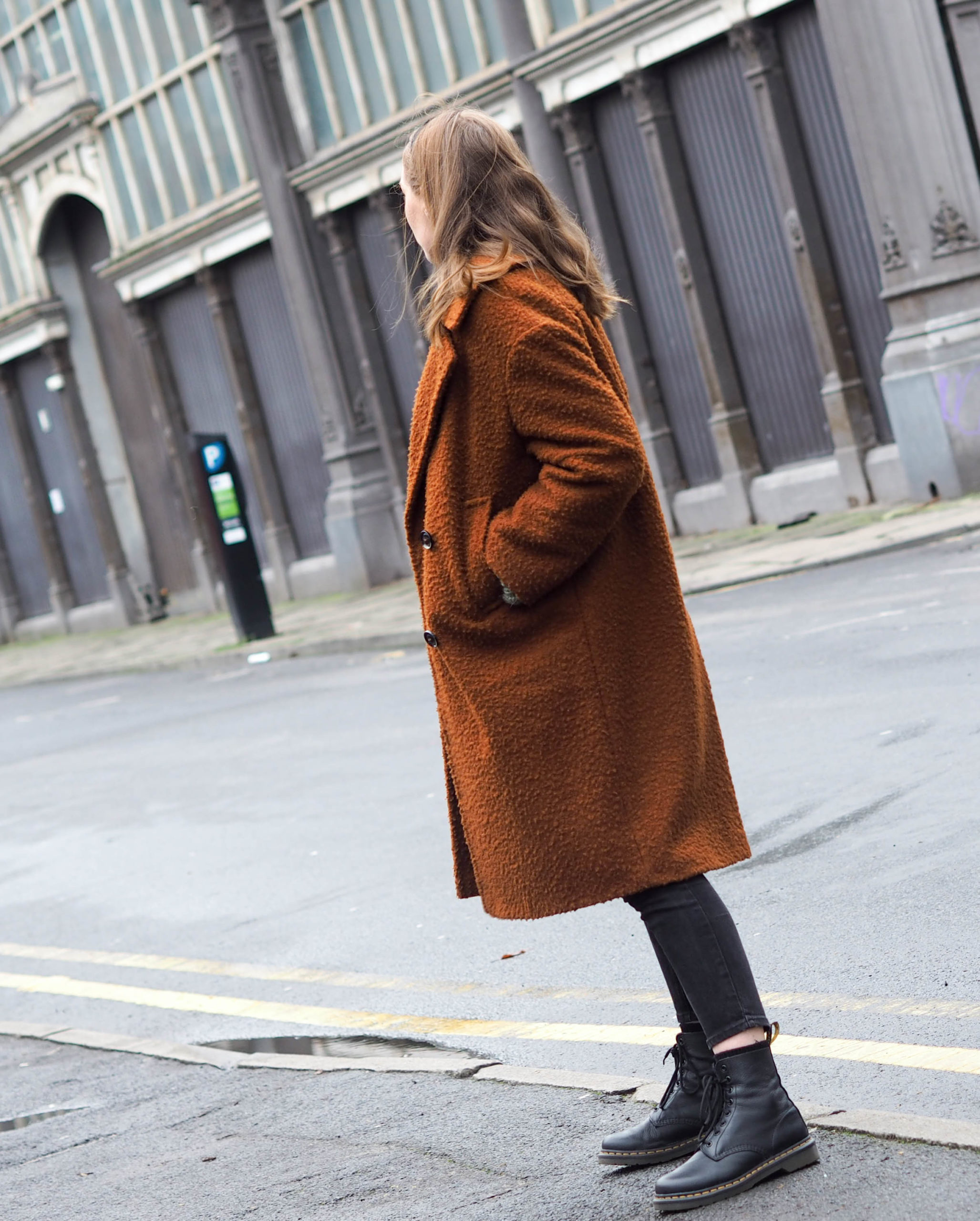 girl in Manchester wearing topshop wool coat and dr marten boots