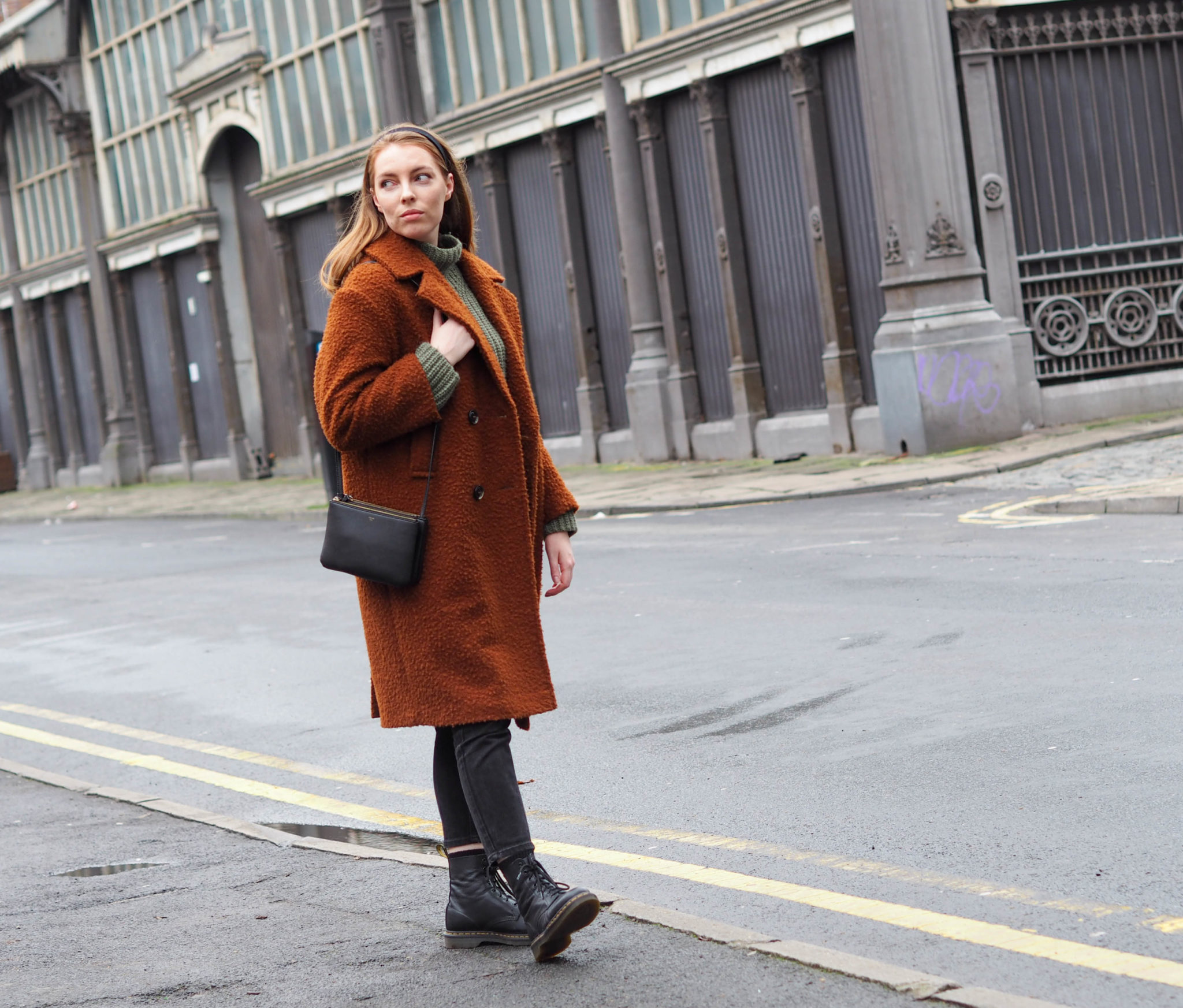 girl in Manchester wearing dr marten boots and topshop wool coat