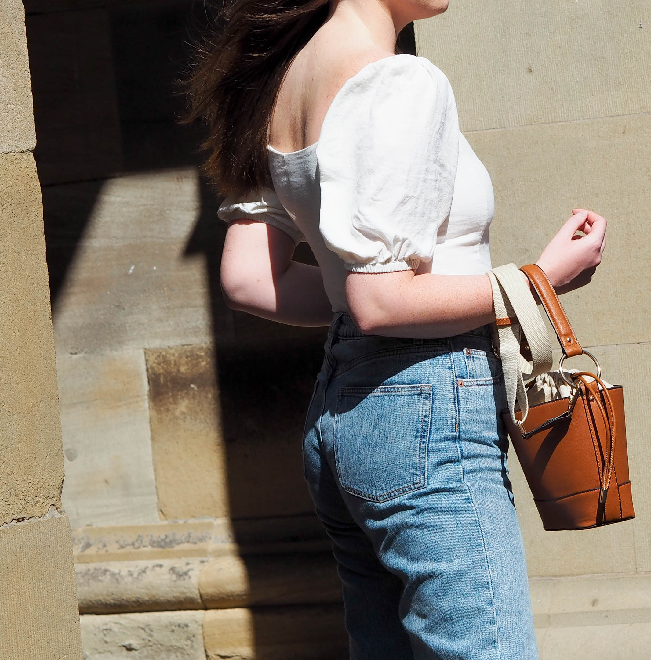 fashion details white linen puff sleeve blouse and retro denim jeans