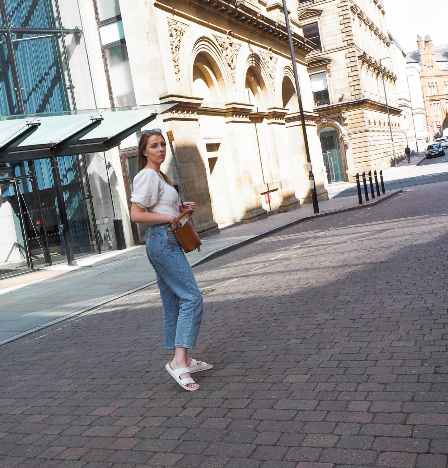 girl wearing mom jeans and linen top in Manchester street style photo