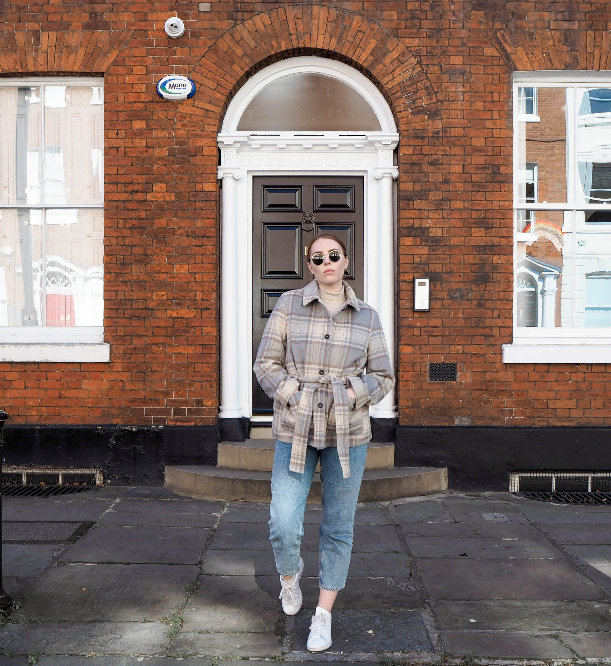 street style photograph girl wearing checked shacket and sunglasses
